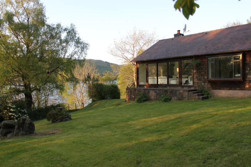 detached house with surrounding gardens, private waterside with fishing rights