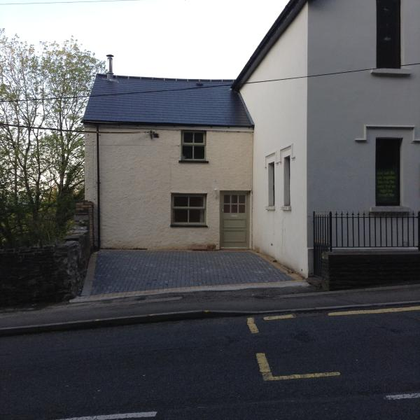 Front of house with off road parking