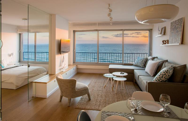 Breathtaking ocean views. A curtain along the glass wall can be closed for privacy.