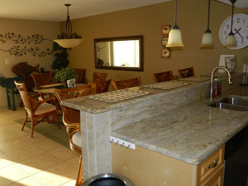 Granite counter tops--looking out to four bar seats.