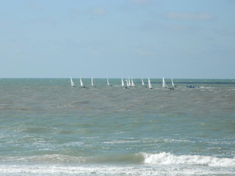 Sailboats off shore.