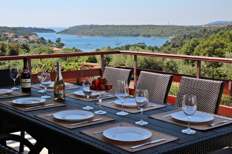 Dining table on upper terrace with amazing seaview