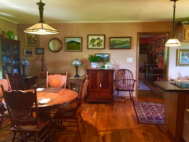 View of open dining room, kitchen area looking into living room