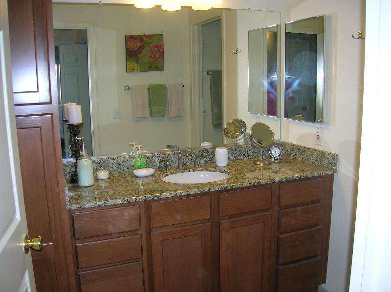 Bathroom has separate vanity area