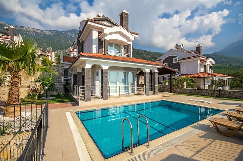 3 bedroom Triplex villa with panoramik Oludeniz view is situated in the peaceful location of Ovacik.