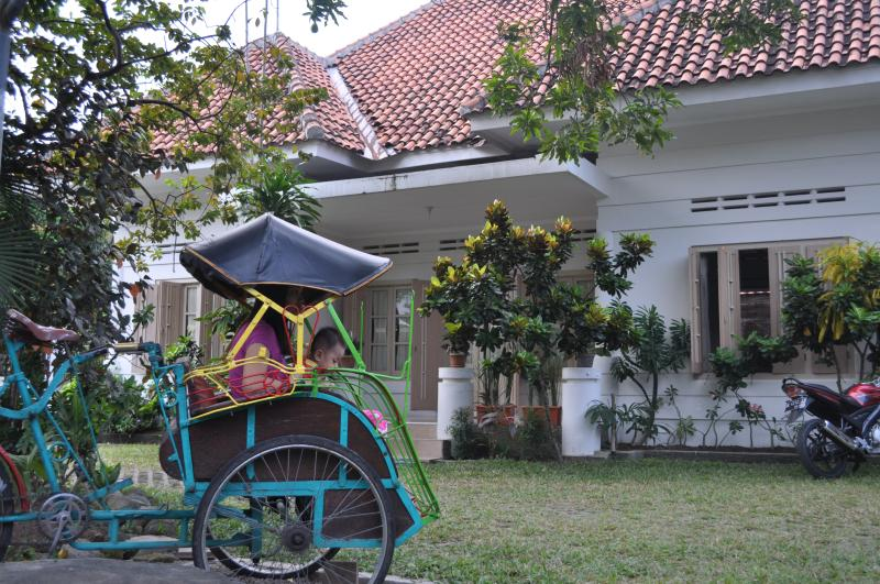 Pakde Wagiyo's becak is ready at the front to take you around the city center
