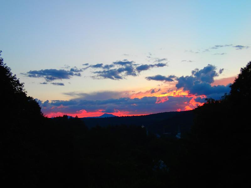 Lovely sunset in the backyard with a view of the dome of the capital and Camel's Hump mountain.