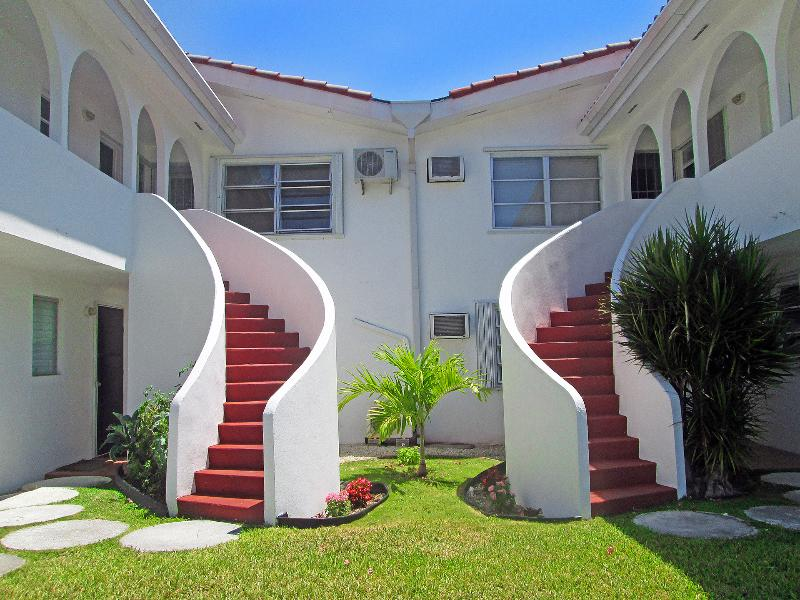 The attractive curved staircases lead to the upstairs apartments. Mine is upstairs on the left.