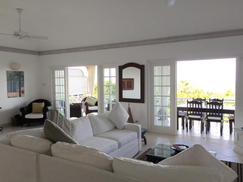 Large living space with French doors that lead onto the balcony.