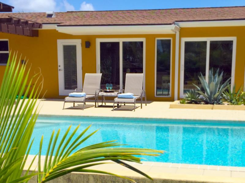 large pool, with full privacy, lounge chairs, landscaped grounds.