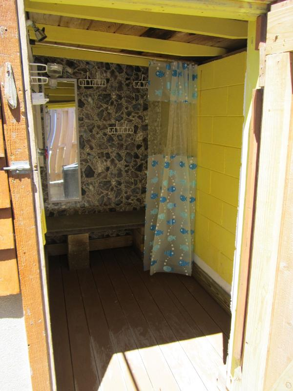 Large Outside Shower w/Dressing Area~clothsline right outside for that wet bathing suit!