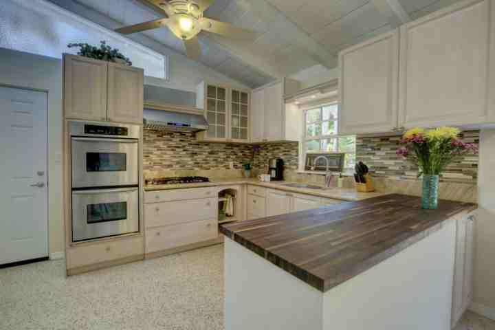 Brand new, squeaky clean kitchen with gas cooktop and double oven for enjoyable meal preparation.