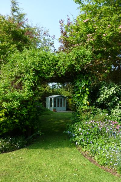 Honeysuckle archway to the summerhouse.