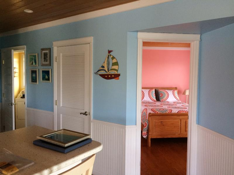 Kitchen and Guest Bedroom with Queen Size Bed and TV