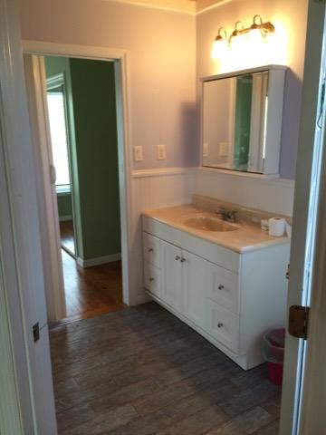 Bathroom on main floor with shower, shared by two guest bedrooms