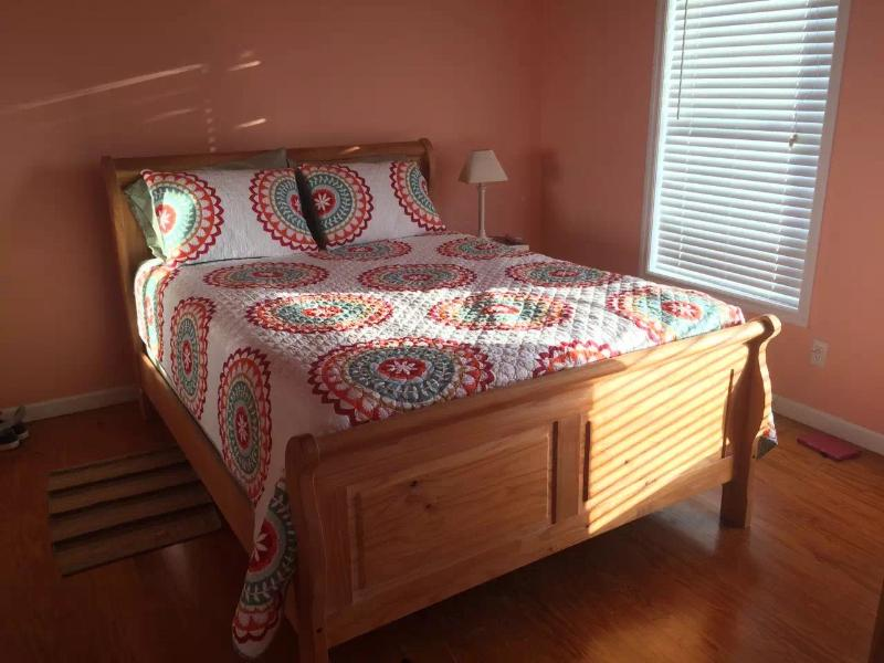 Guest Bedroom with Queen Size Bed and TV