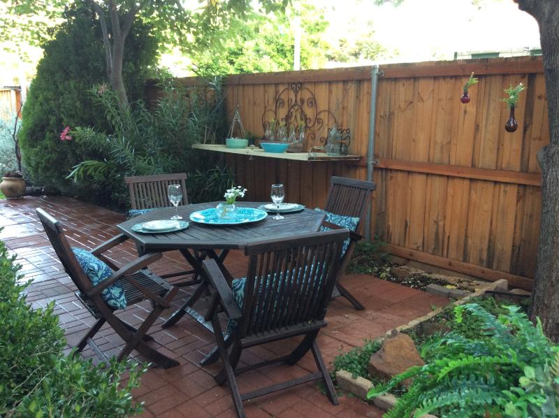 Shaded patio. Outdoor lighting and serving table for parties