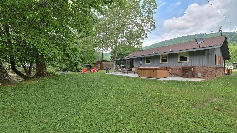 Nice level back yard with concrete patio.  Enjoy sitting on the bank of the bold creek.