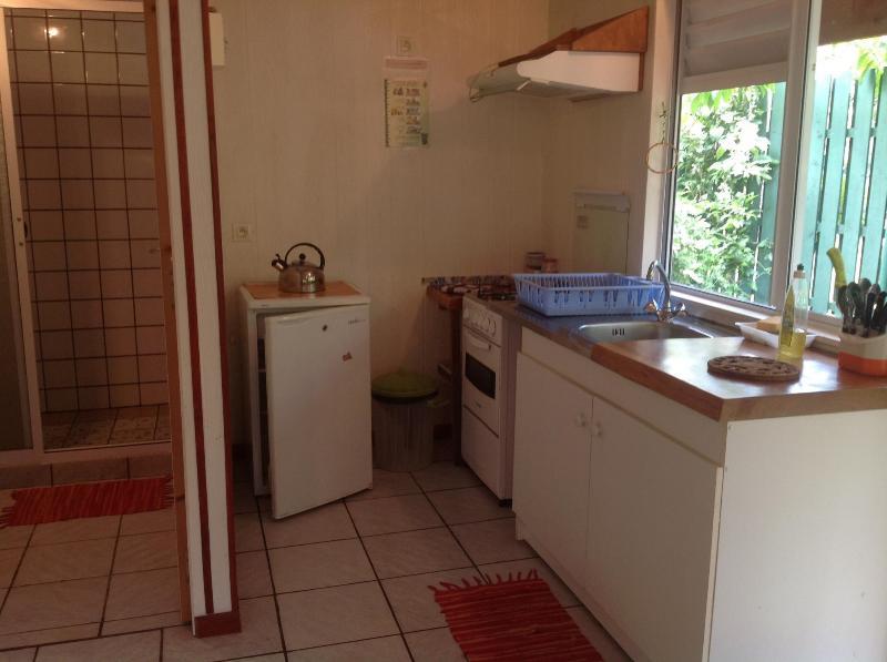 Kitchen beside bathroom