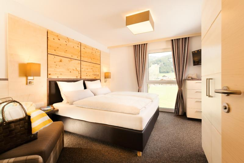 The double bed bedrooms in the apartment Alpenrose