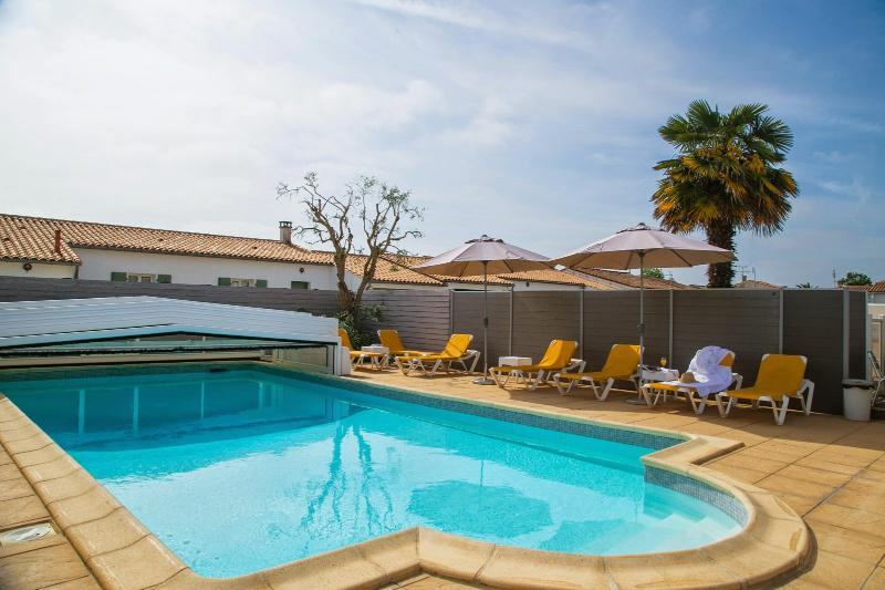 Access to the outdoor heated pool and solarium