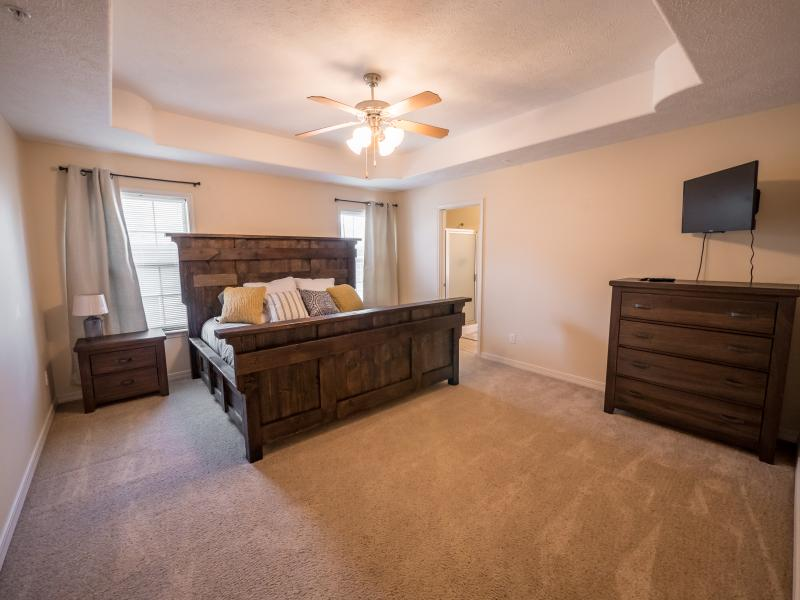 Master Bedroom with coustom built king bed and a 32' HDTV.