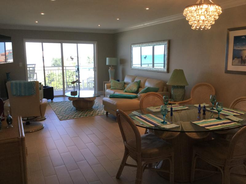 Large spacious living room and dinning room with ocean view.