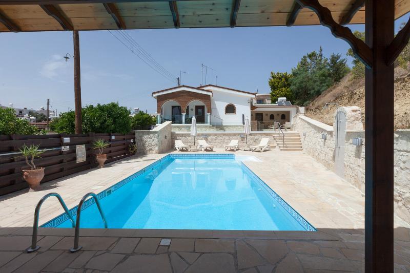 Villa viewed across pool from gazebo.