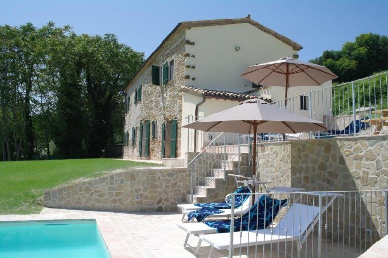 dolce far niente on terraces around the pool, side view of Casa Brizzi