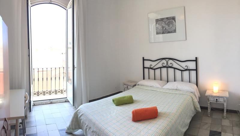 Bedroom with double bed . Balcony with views to Picasso area, Alcazaba and Plaza de la Merced