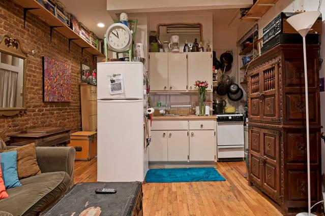 Another view of den/kitchenette. Hardwood, antiques, brick walls, high ceiling and awesome lighting!