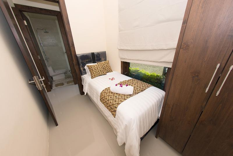 Villa 1 - The other bedroom , it has 2 single bed that can be pull out from the bottom .
