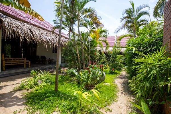 Quiet room with garden view, alquiler vacacional en Hoi An