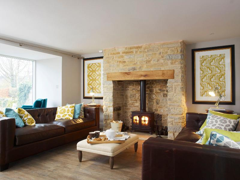 Drawing room with log burner and doors onto patio and garden