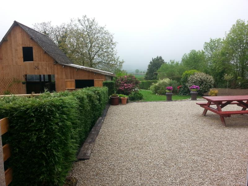 The view from the breakfast room out to the garden and the barn