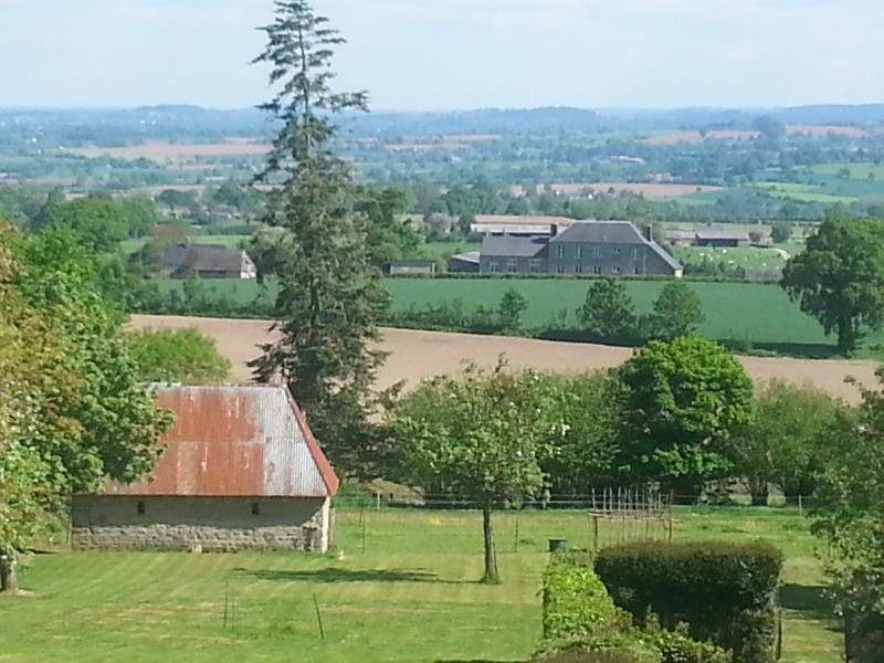 The bedroom view over the garden and the valley