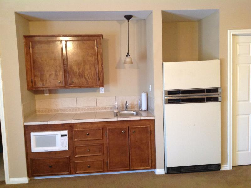 Butlers kitchen area, microwave and full size refrigerator