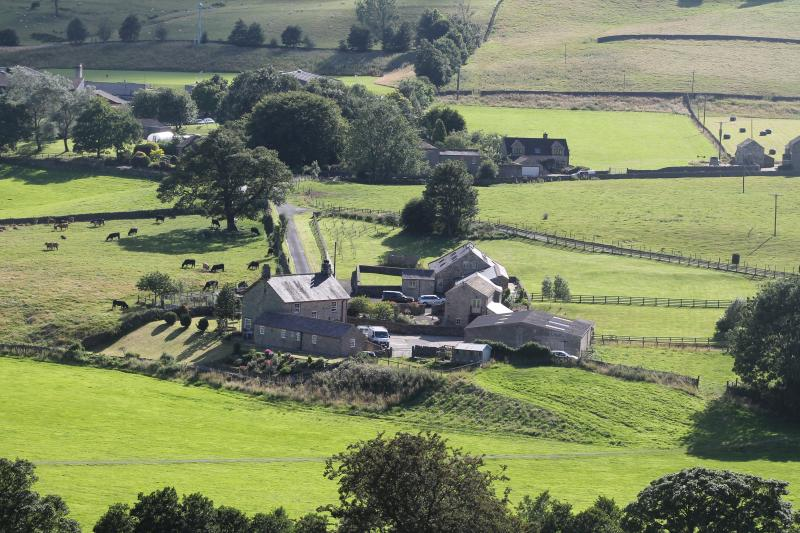 The house and holiday cottage from the hills.