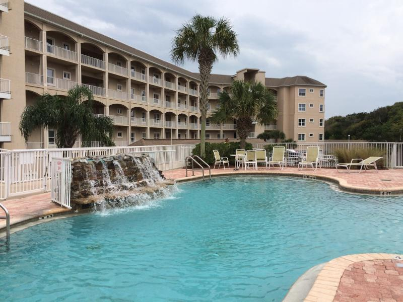 Another view of pool with waterfall and Ocean Park Condominiums in the background