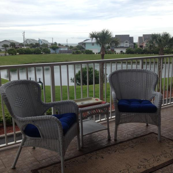 Additional seating on private balcony with beach and ocean in the background