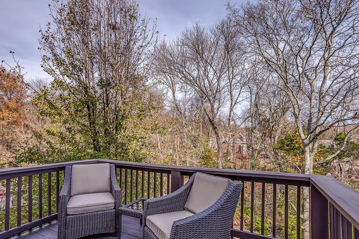 Private deck overlooking backyard.