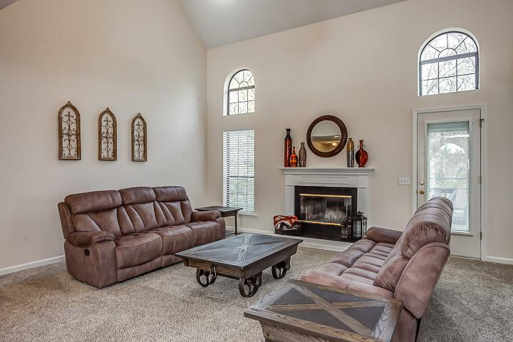 Comfortable seating and gas fireplace in living room.
