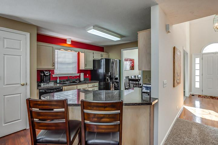 Fully furnished kitchen including a Keurig Coffee Maker.