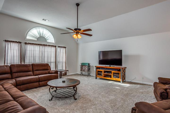 Large bonus room with comfy sectional and 65' TV. Seating for 9.