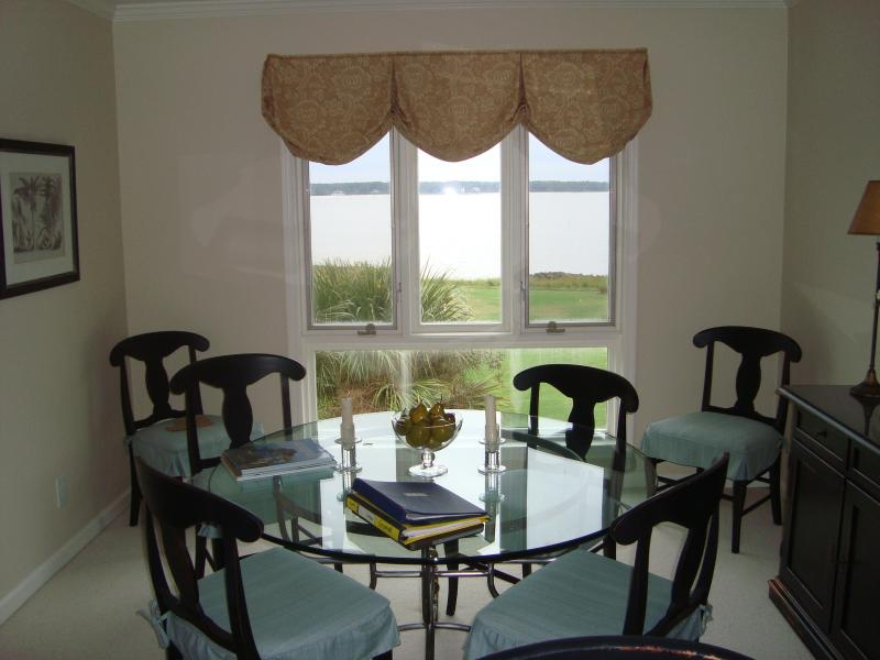 Dining room with view of golf and water