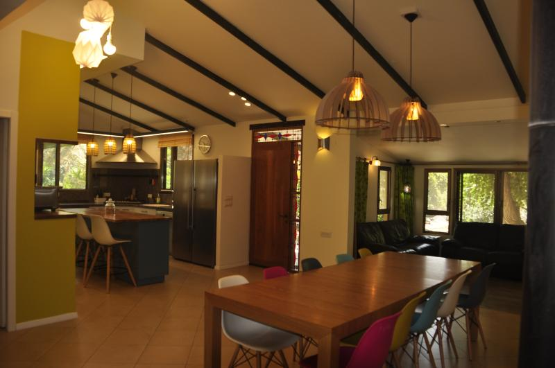 View of the dining table and front door& kitchen & Living room