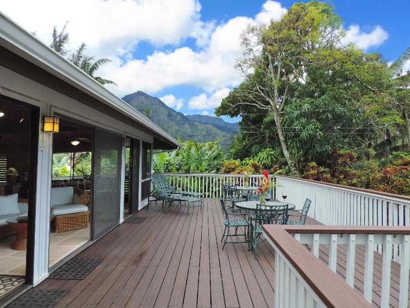 Large wraparound deck features great ocean and mountain views and tables for outdoor dining
