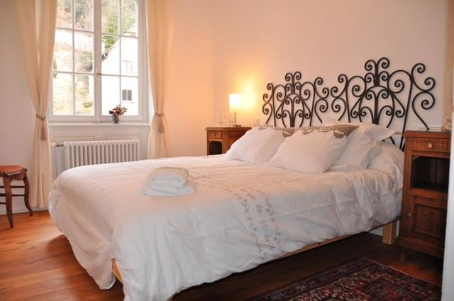 bedroom with with a nice view of the ferrette castle