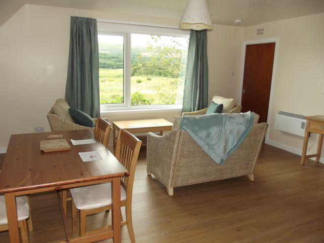 Glen Houses Mull, Chalet 2, living room with fantastic views over Glen Bellart.