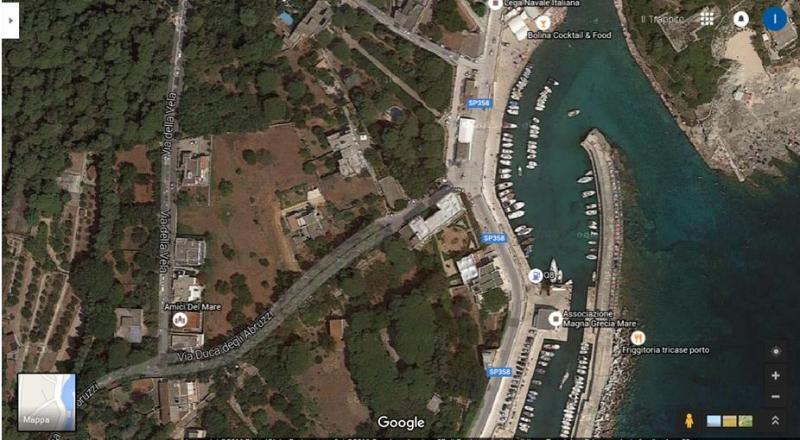 A view from above!! The house is the large, grey, U-shaped building just left of the port